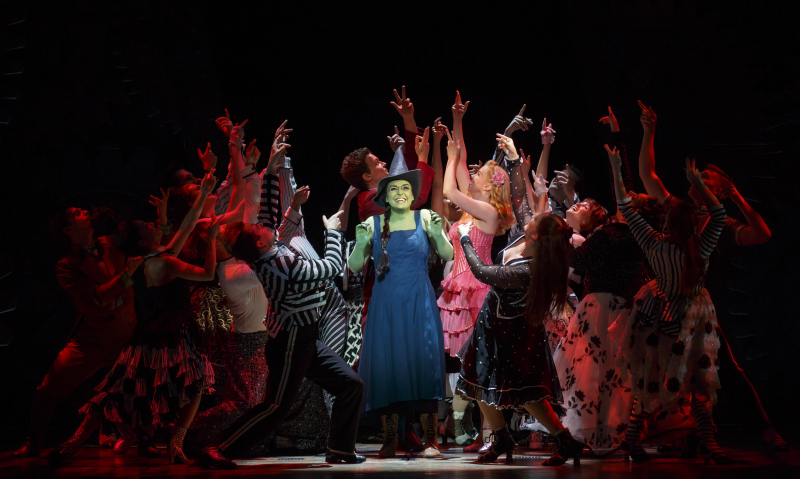 Jessica Vosk as Elphaba and Ginna Claire Mason as Glinda and the North American Touring Company of WICKED. Photo by Joan Marcus